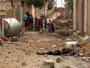 Dozens killed, buried in rubble after Mosul air raid