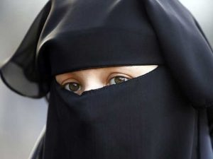 Quebec passes controversial face veil ban