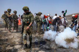 Israel arrests Palestinian activist weeks after footage circulates of soldier kneeling on his neck