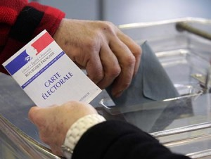 A man casts a ballot at a polling station in the first round of the 2012 French presidential election in Strasbourg